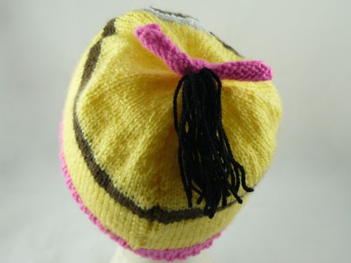 <p><span>Image of the back of the childs character hat. &nbsp; This image shows the pony tail at the back of the hat. This is a free novelty knitting pattern from the Nixneedles Novelty Knits collection.</span></p>