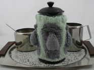Free knitting pattern for an Easter Island Cafetiere Cosy