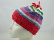 Free knitting pattern for childs stripy hat with tie top