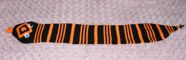 an orange and black striped rattle snake scarf